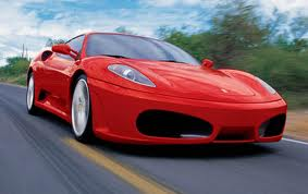 Red Ferrari on the road